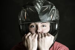 Danger and adrenaline are my name - portrait of a woman in a motorcycle helmet royalty free stock photos