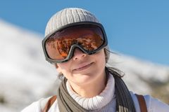 Portrait of a woman at mountain Ziria in Greece wearing ski sunglasses. Stock Photo