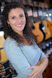 Portrait woman in musical instrument shop Stock Image