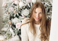 Portrait of a woman near the Christmas tree. Portrait of a girl closeup Stock Photo