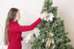 Portrait of a woman near a Christmas tree. Royalty Free Stock Photos