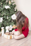 Portrait of a woman near a Christmas tree. Royalty Free Stock Images