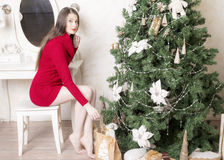 Portrait of a woman near a Christmas tree. Royalty Free Stock Photography