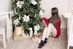 Portrait of a woman near a Christmas tree. Royalty Free Stock Image