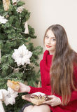 Portrait of a woman near a Christmas tree. Stock Image