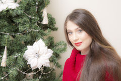 Portrait of a woman near a Christmas tree. Stock Photo