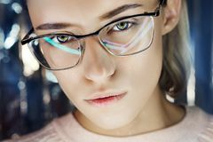 Portrait of a woman in neon colored reflection glasses in the background. Good vision, perfect makeup on girl face. Art portrait. Of a flare and bokeh on the stock images