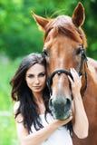 Portrait woman next horse. Portrait beautiful woman long hair next horse Royalty Free Stock Photo