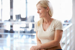 Portrait of woman in office smiling Stock Photos