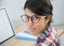 Portrait of woman office worker in front of computer Royalty Free Stock Image