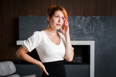 Portrait of a woman office worker holding his head. Royalty Free Stock Images