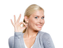 Portrait of woman okay gesturing Stock Image