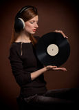 Portrait of woman with old gramophone record Royalty Free Stock Images