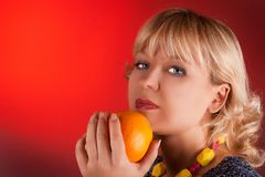 Portrait woman with orange Stock Images