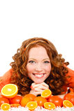 Portrait of a woman with oranges on white Royalty Free Stock Photography