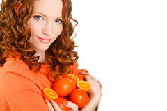 Portrait of a woman with oranges on white Stock Images