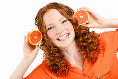 Portrait of a woman with oranges on white Royalty Free Stock Image