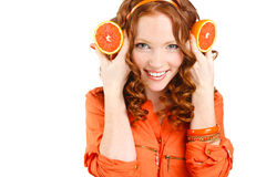 Portrait of a woman with oranges on white Stock Image