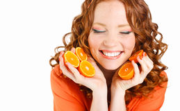Portrait of a woman with oranges on white Royalty Free Stock Photos