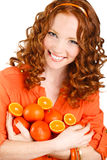 Portrait of a woman with oranges on white Stock Photography