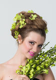 Portrait of woman with orchid flower in hair posing Stock Photography