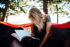 Portrait of woman outdoors with a book Stock Photo