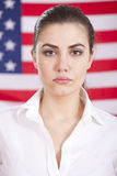Portrait of woman over american flag Royalty Free Stock Photography