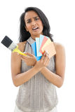 Portrait of a woman with paint samples and paintbrush Royalty Free Stock Photos