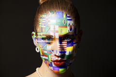 Portrait of woman with painted with Flags all countries of world. Isolated on black royalty free stock image