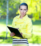 Portrait of woman with paper folder. Student Stock Photography