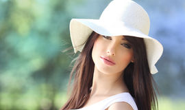 Portrait of a  woman in  park. Royalty Free Stock Photo
