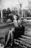 Portrait of woman on park bench Stock Photos