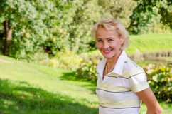 Portrait of a woman in a park on a sunny day Royalty Free Stock Images
