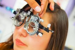 Portrait of woman patient in oftalmolog cabinet does eye diagnostics in a blurred background.  royalty free stock photo