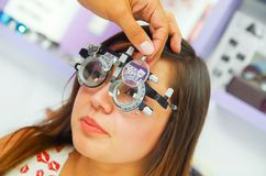 Portrait of woman patient in oftalmolog cabinet does eye diagnostics in a blurred background.  stock photography