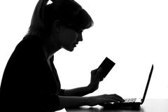 Portrait of a woman paying for home services with a credit card Royalty Free Stock Photo