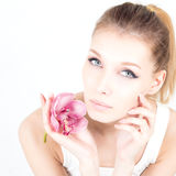 Portrait of woman with permanent make up holding pink flower. Portrait with permanent make up holding pink flower Royalty Free Stock Photos