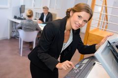Portrait woman at photocopier. Portrait of women at photocopier Royalty Free Stock Images