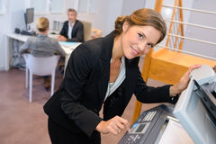 Portrait woman at photocopier. Portrait of women at photocopier Royalty Free Stock Image