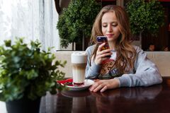 Portrait of Woman Photographing With Smart Phone Royalty Free Stock Images