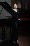 Portrait of Woman With Piano Stock Image