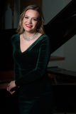 Portrait of Woman With Piano Royalty Free Stock Image