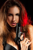 Portrait of woman with pistol Stock Photo