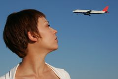 Portrait of woman with a plane. Portrait of a woman looking at a transport aircraft Royalty Free Stock Images