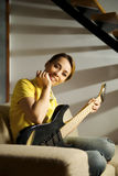 Portrait of woman playing with electric guitar at home royalty free stock image