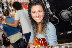 Portrait woman playing electric guitar Royalty Free Stock Image