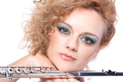 Portrait of a woman playing flute Stock Image