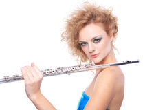 Portrait of a woman playing flute Stock Photos