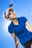 Portrait of a woman playing golf on sky Royalty Free Stock Image