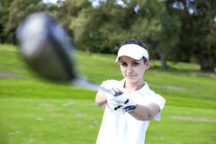 Portrait of a woman playing golf Royalty Free Stock Photo